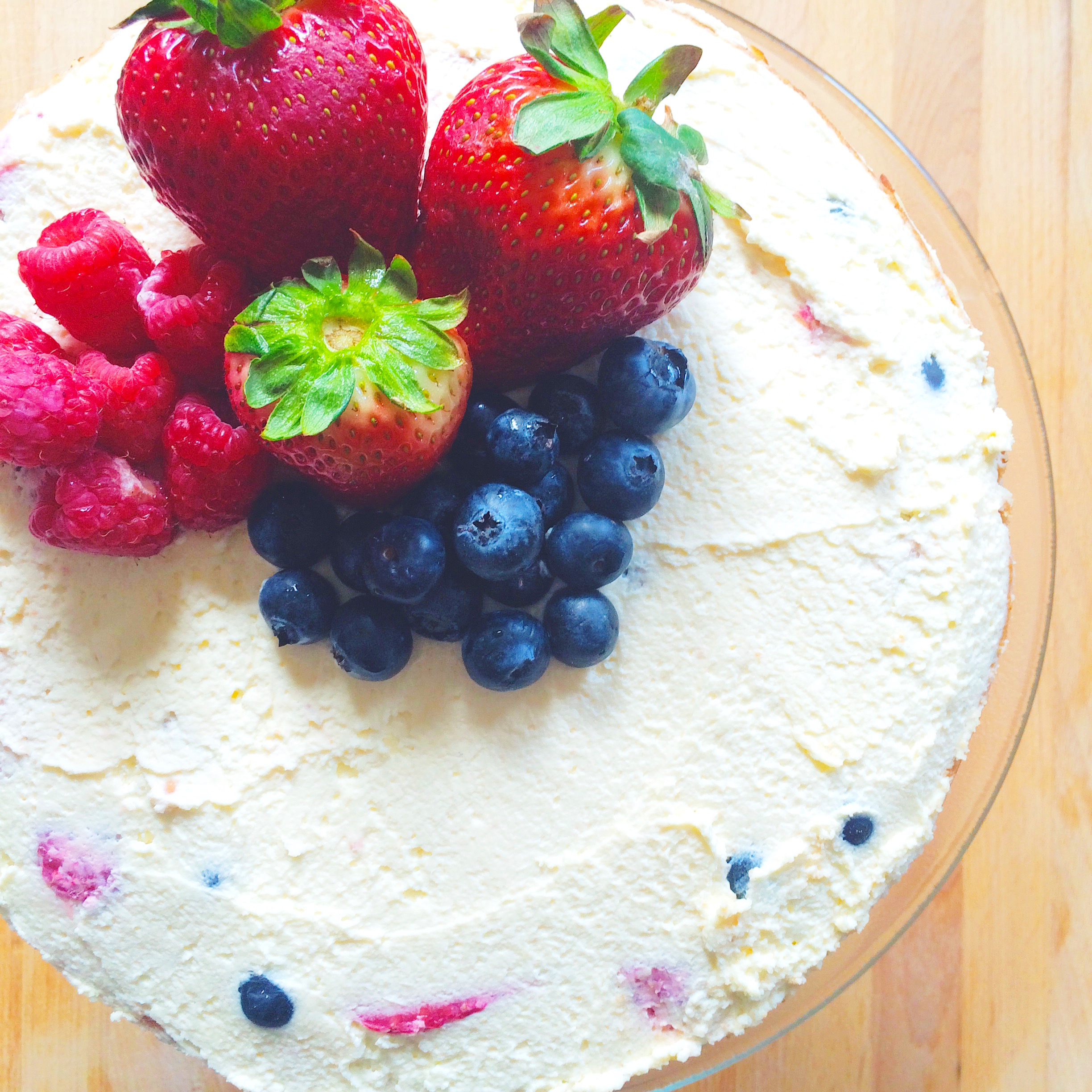 triple berry genoise cake with whipped cream frosting born and